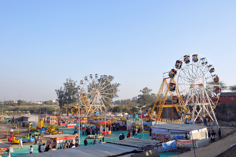 Mela outside the Surajkund Mela venue leveraging on the footfall.<br /> Surajkund Crafts Mela 2011 held near Delhi in Faridabad, Haryana, North India. The annual Suraj Kund Mela (fair) is an event held in February each year where artisans, craftsmen, musicians & dancers come together and entral thousands of visitors. It is also a great shopping bonanza and delight to the palate with the range of food.