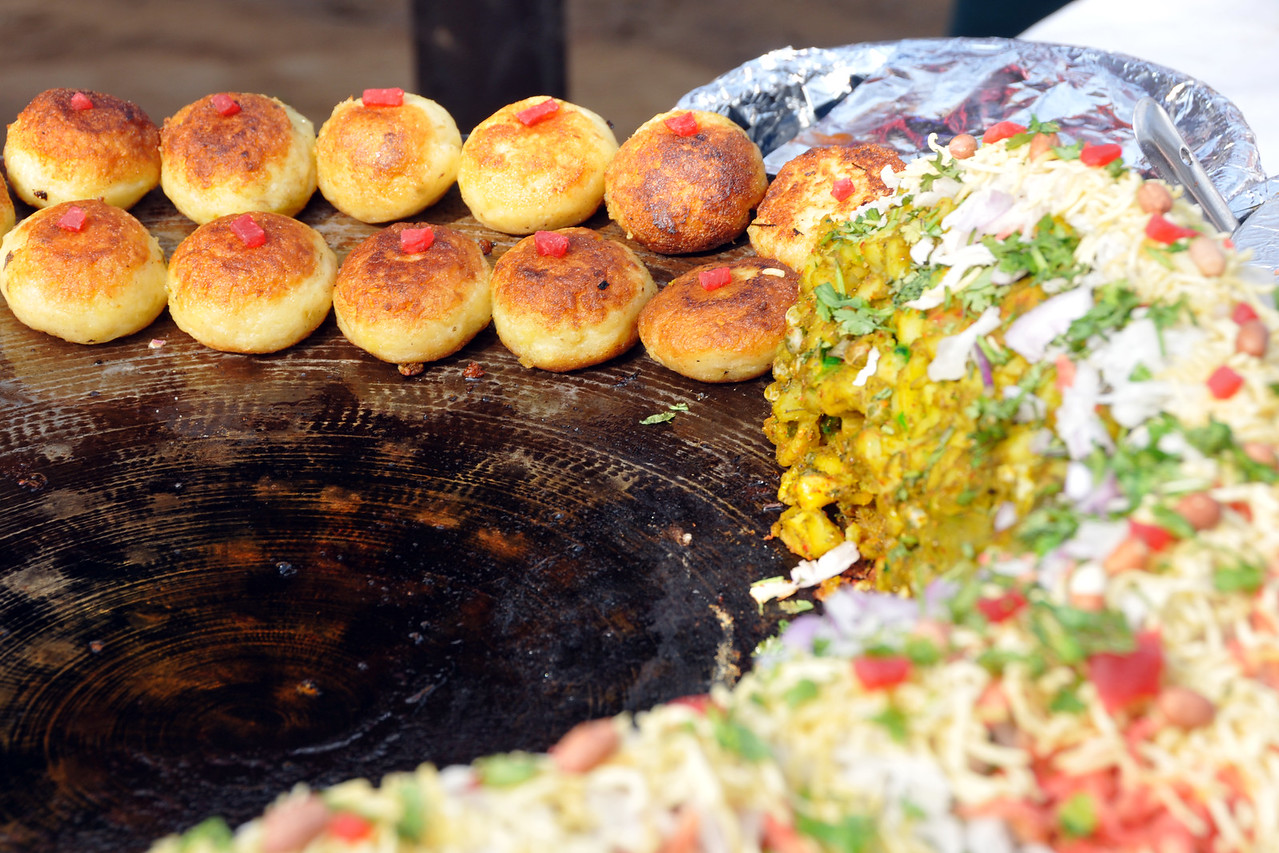 Variety of options at the food court.<br /> <br /> Surajkund Crafts Mela 2011 held near Delhi in Faridabad, Haryana, North India. The annual Suraj Kund Mela (fair) is an event held in February each year where artisans, craftsmen, musicians & dancers come together and entral thousands of visitors. It is also a great shopping bonanza and delight to the palate with the range of food.
