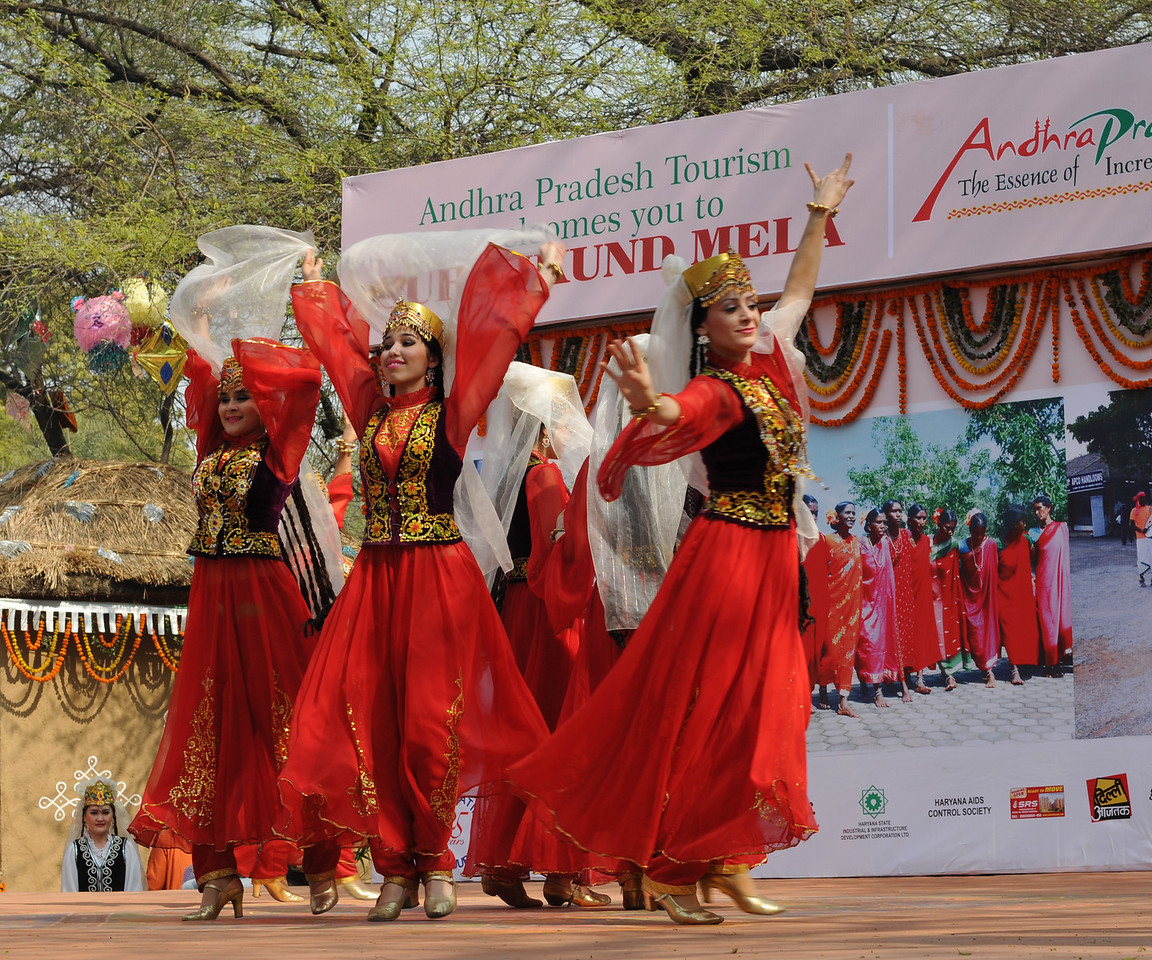 Artist from Uzbekistan perform their traditional dance and music to a large crowd at Suraj Kund Mela.<br /> <br /> Surajkund Crafts Mela 2011 held near Delhi in Faridabad, Haryana, North India. The annual Suraj Kund Mela (fair) is an event held in February each year where artisans, craftsmen, musicians & dancers come together and entral thousands of visitors. It is also a great shopping bonanza and delight to the palate with the range of food.