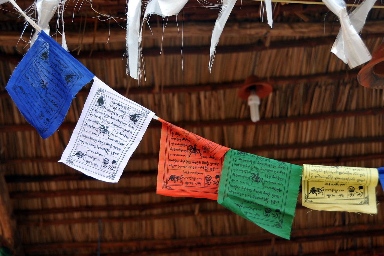 Prayer flags from Bhutan blow in the wind.<br /> <br /> Surajkund Crafts Mela 2011 held near Delhi in Faridabad, Haryana, North India. The annual Suraj Kund Mela (fair) is an event held in February each year where artisans, craftsmen, musicians & dancers come together and entral thousands of visitors. It is also a great shopping bonanza and delight to the palate with the range of food.
