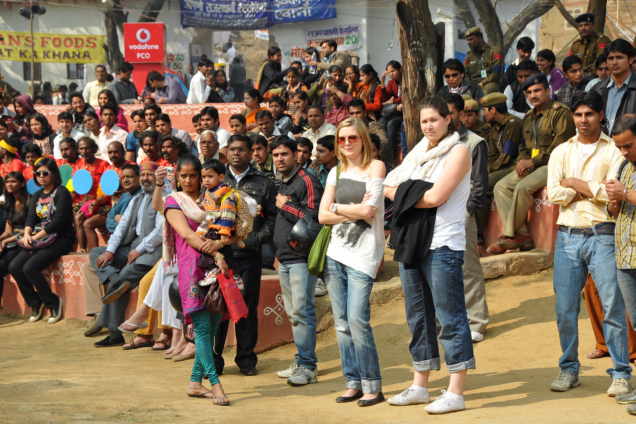 Mixed crowds from many countries enjoy the performances at the mela. <br /> <br /> Surajkund Crafts Mela 2011 held near Delhi in Faridabad, Haryana, North India. The annual Suraj Kund Mela (fair) is an event held in February each year where artisans, craftsmen, musicians & dancers come together and entral thousands of visitors. It is also a great shopping bonanza and delight to the palate with the range of food.