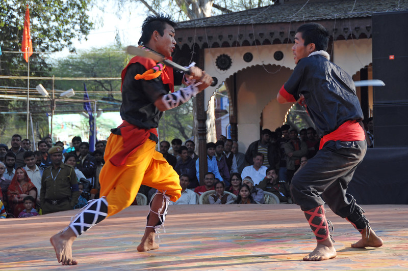 Martial artists from North East India demonstrate their art.<br /> <br /> Surajkund Crafts Mela 2011 held near Delhi in Faridabad, Haryana, North India. The annual Suraj Kund Mela (fair) is an event held in February each year where artisans, craftsmen, musicians & dancers come together and entral thousands of visitors. It is also a great shopping bonanza and delight to the palate with the range of food.