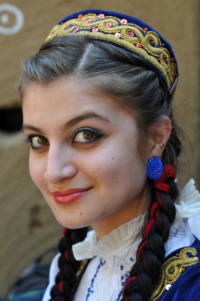 Portrait of the lovely girl artist from Kazakhstan at Suraj Kund.<br /> <br /> Surajkund Crafts Mela 2011 held near Delhi in Faridabad, Haryana, North India. The annual Suraj Kund Mela (fair) is an event held in February each year where artisans, craftsmen, musicians & dancers come together and entral thousands of visitors. It is also a great shopping bonanza and delight to the palate with the range of food.