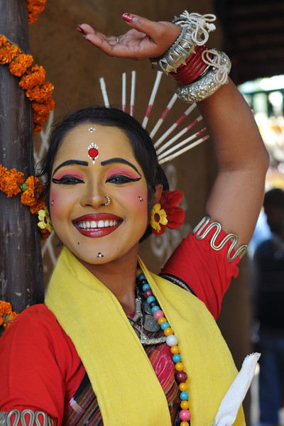 Dancer from Dayal Sangeet Academy, Rasulgargh, Bhubaneshwar, Orissa striking a pose at Suraj Kund Mela. She is an Odissi and Sambalpuri folk dancer. <br /> Surajkund Crafts Mela 2011 held near Delhi in Faridabad, Haryana, North India. The annual Suraj Kund Mela (fair) is an event held in February each year where artisans, craftsmen, musicians & dancers come together and entral thousands of visitors. It is also a great shopping bonanza and delight to the palate with the range of food.