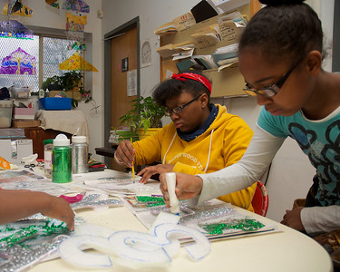 123012, Roxbury, MA - Rayauna Moss Cousin, 14, left, and Sophia Gaines, 10, work on decorations at the Hawthorne Youth and Community Center for the First Night Celebration. Herald photo by Ryan Hutton