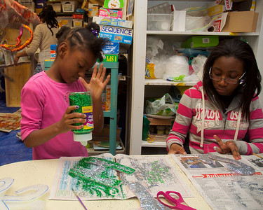 123012, Roxbury, MA - Rayven Moss, 6, left, and Cincere Carkeor, 13, right, work on decorations at the Hawthorne Youth and Community Center for the First Night Celebration. Herald photo by Ryan Hutton