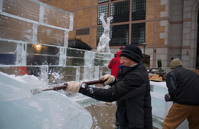 123012, Boston, MA - Don Chapelle, of Brilliant Ice Sculptures, works on an ice sculpture of a whale outside the Prudential Center while his crew starts arranging blocks for other works in time for the First Night Celebration. Herald photo by Ryan Hutton