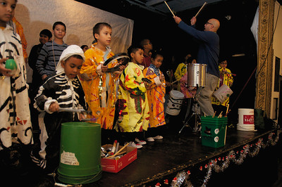 122712, Jamaica Plain, MA - Children practice drumming at Spontaneous Celebrations as practice for the First Night celebration in Boston. Herald photo by Ryan Hutton