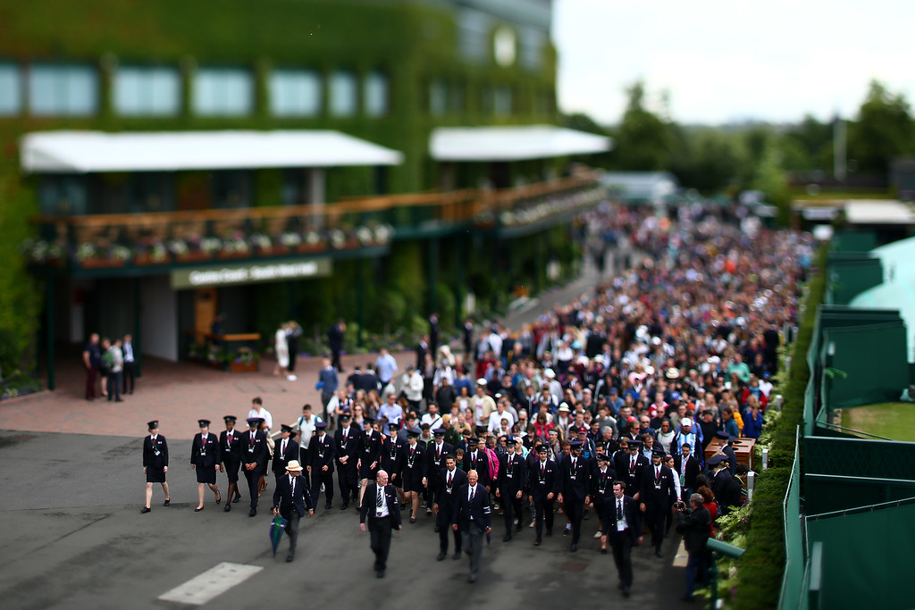 Spectators are led into the ground ahead of the start of day five of the Wimbledon Lawn Tennis Championships at the All England Lawn Tennis and Croquet Club on July 1, 2016 in London, England.