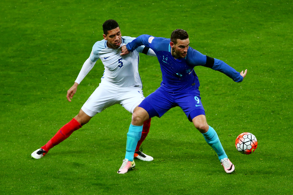 Vincent Janssen of the Netherlands fends off Chris Smalling of England during the International Friendly match between England and Netherlands at Wembley Stadium on March 29, 2016 in London, England.