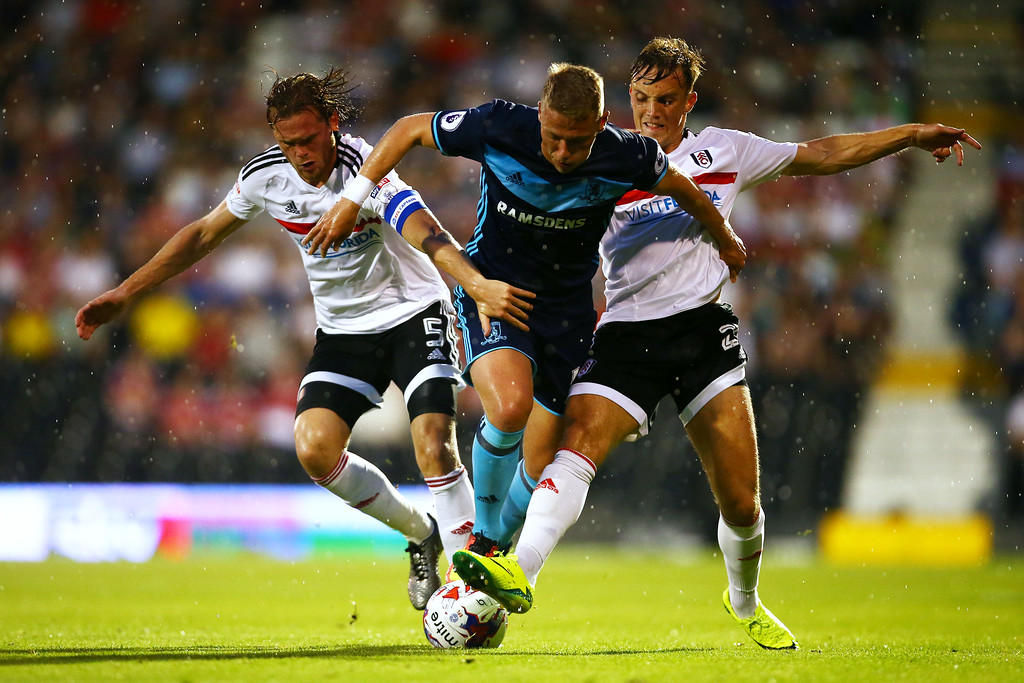 Viktor Fischer of Middlesbrough takes on Richard Stearman and Vigen Christensen of Fulham during the EFL Cup second round match between Fulham and Middlesbrough at Craven Cottage on August 24, 2016 in London, England.