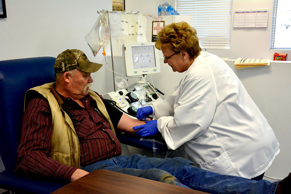 Joann Heurman, right, of the Red Cross, preps Bill Kreke of Edgewood to give blood at the Red Cross blood drive. Early January's storms left local blood banks low after many drives had to be canceled.