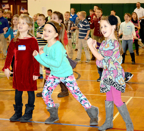 From left, Veronica Sudkamp, Addison Bunton and Mia Kinkelaar celebrate Catholic Schools Week by dancing in the Sacred Heart School gym with other students from Sacred Heart, St. Anthony, Sigel St. Michael, St. Thomas in Newton. The girls are kindergarten students at St. Anthony Grade School.