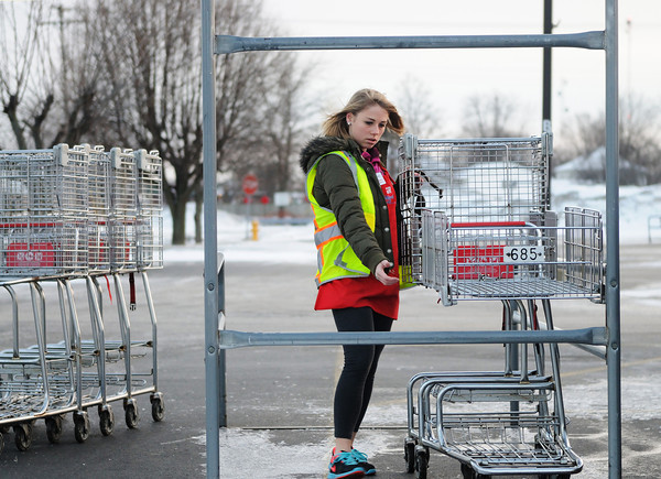 Charlotte Wente corrals shopping carts in the martin's iga parking lot Tuesday afternoon.