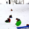 Sledders enjoy the snow.