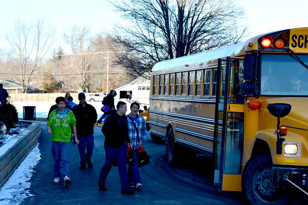 Students at Newton Community High School board the bus after school Thursday. The District is looking for alternatives to keeping students in class after using nine snow days in December and January.