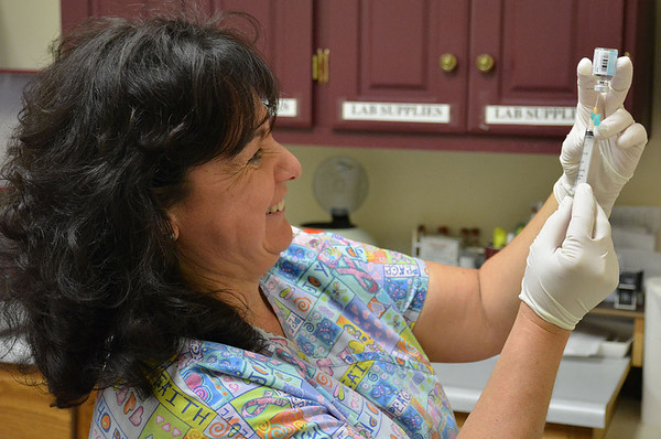 Crystal Schutzbach, clinic coordinator at the Effingham County Health Department, prepares a flu vaccine. An outbreak of the flu has led to more than 60 positive tests of Influenza A at St. Anthony's Memorial Hospital.