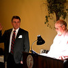 Effingham Area Home Builders Association President Marty Stock is sworn in by Moe Kemme at the group's annual banquet and installation of officers.