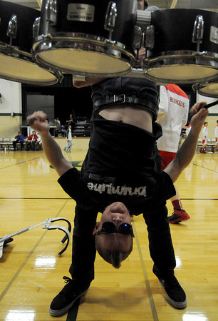 "Stewardson-Strasburg senior Jonah Slifer plays ""521"" on the quad toms upside down prior to the Stewardson-Strasburg/St. Anthony varsity basketball game Friday evening. <br /> Chet Piotrowski Jr. photo"