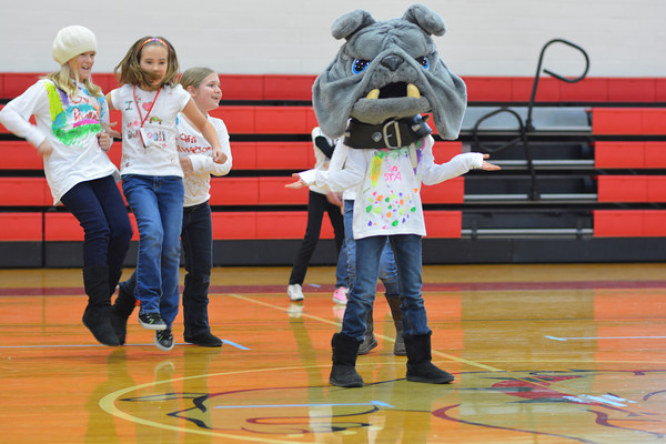 St. Anthony Grade School students, from left, Anna Kabbes, Elizabeth Kabbes, Alexis Stephens and Alayna Stephens in bulldog mascot head perform during a talent show Friday.