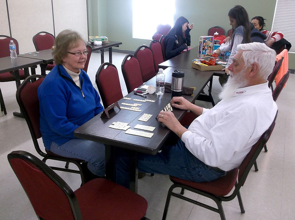 Jane, left, and Frank Perrin of Centennial, Colo., enjoy a game of Rummikub at the Ron Diehl Center. The Perrins were stranded near the Interstate 70 rest area between Effingham and Altamont while on their way home from a family gathering.