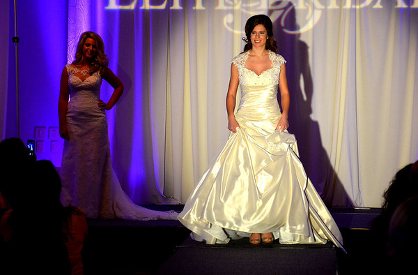 Models display wedding gowns at the 24th Annual Bridal Expo at the Thelma Keller Convention Center Sunday. More than 300 brides-to-be were expected to attend.