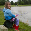 "Lexi Landrus, 7, of Mattoon, laughs while fishing during the Fishing For Kids event at the Brandt's property. Landrus' father, Mike, said they saw the flyer last minute and decided the night before to go. ""Since it's summer, we would like to do this more often,"" Mike Landrus said."