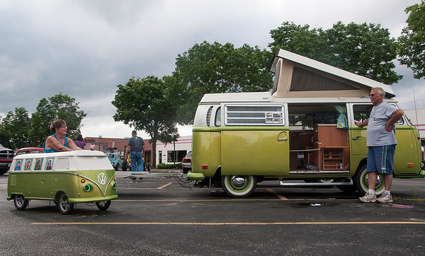 """Barb Weiderman, left, and husband Jim relax in the parking lot during the VW fest parade. Barb said this is their second year attending the Effingham fest. """"My husband made this little VW a little over two years ago and he plans to make more to sell next year,"""" Barb said."""