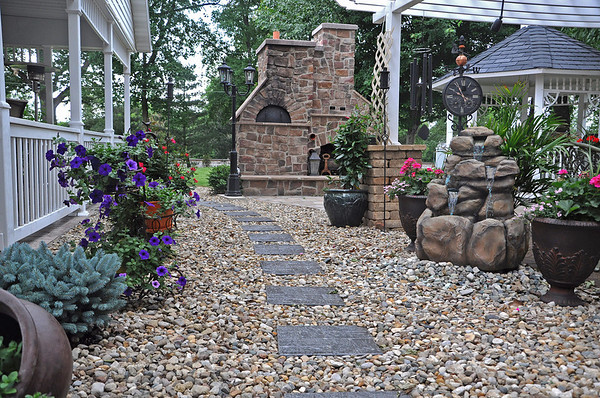 Diana and Del Althoff's backyard garden features an outdoor pizza oven.