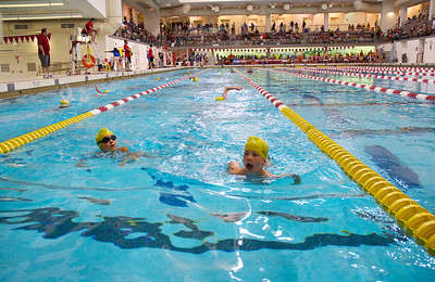 072212, Cambridge, MA - Participants in the Inaugural New England Kids Triathlon compete in the 100 yard swim portion of the event at M.I.T.'s Johnson Athletic Center. Herald photo by Ryan Hutton