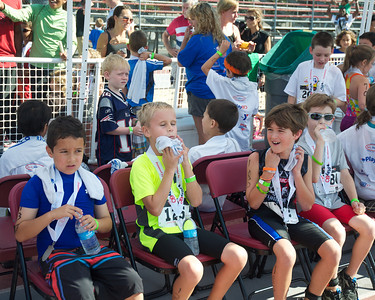 072212, Cambridge, MA - From left, Dimitrios Passias, 8, of Taunton, Nathan Coleman, 8, of Attleboro, William Navas, 9, of Southbury, Conn., and Everett Chapman, 9, of Sandwich rest and cool down after finishing the inaugural New England Kids Triathlon at M.I.T.'s Johnson Athletic Center. Herald photo by Ryan Hutton