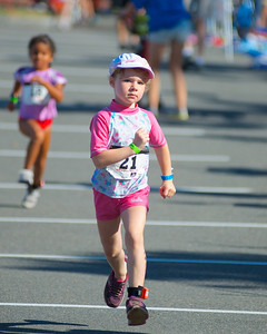 072212, Cambridge, MA -  Madeline Lyons, 6, of Stoughton dashes along during the half mile run portion of the inaugural New England Kids Triathlon at M.I.T.'s Johnson Athletic Center. Herald photo by Ryan Hutton