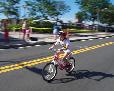 072212, Cambridge, MA -  June Padera, 9, of Milton, zips along Vassar Street during the three mile bike ride portion of the inaugural New England Kids Triathlon at M.I.T.'s Johnson Athletic Center. Herald photo by Ryan Hutton