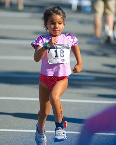 072212, Cambridge, MA -  Gabriela Castano, 6, of East Providence, R.I., hustles during the half mile run portion of the inaugural New England Kids Triathlon at M.I.T.'s Johnson Athletic Center. Herald photo by Ryan Hutton
