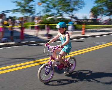 072212, Cambridge, MA -  Molly Lunch, 9, of Worcester zips along Vassar Street during the three mile bike ride portion of the inaugural New England Kids Triathlon at M.I.T.'s Johnson Athletic Center. Herald photo by Ryan Hutton