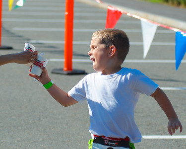 072212, Cambridge, MA -  Cole McKirryher, 6, of Thomaston, Conn., grabs some water during the half mile run portion of the inaugural New England Kids Triathlon at M.I.T.'s Johnson Athletic Center. Herald photo by Ryan Hutton