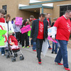 Volunteers try to walk a mile in high heels at Altamont High School as part of Walk a Mile in Her Shoes. The event was held to raise awareness for women from sexual assault and abuse.