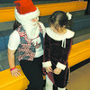 Christmas is a ways off, but Altamont Lutheran Interparish School kindergartener Madison Durbin, right, takes time to tell Santa (ALIS eighth-grader Chelsea Giovanetti) what she wants for Christmas. The girls were dressed up to portray their favorite holiday as part of Lutheran Schools Week.
