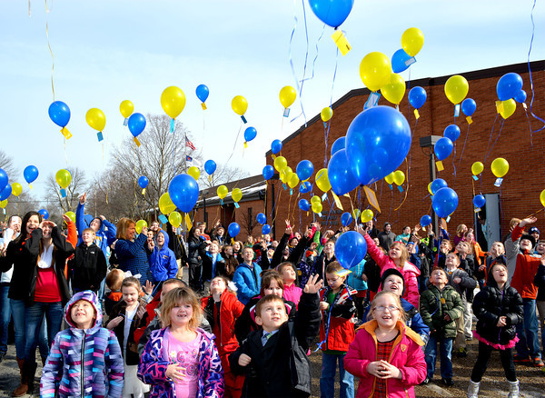 Altamont Lutheran Interparish School students released balloons containing scripture-based messages as part of Lutheran Schools Week. Students, ranging in grade level from kindergarten to eighth grade, added the school's return address for anyone who finds a balloon and wants to write back to students. The students also celebrated the school's 40th year in operation.