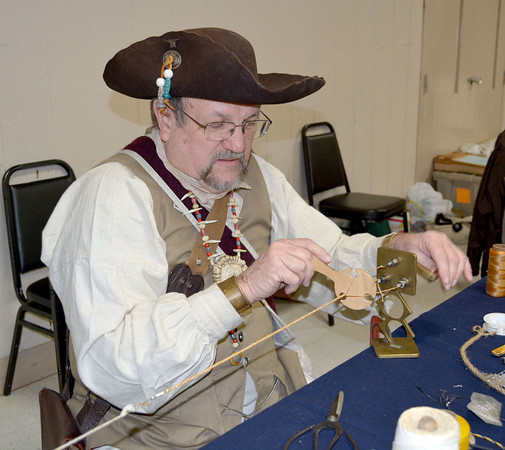 Local historian Lyle Kruger, a direct descendant of one of Effingham County's first county commissioners, shows how rope was made in the 19th century. Kruger was demonstrating this pioneer skill at the 25th annual Prairieland Frontiersman Historic Arms and Craft Show Saturday in Teutopolis. Kruger's great-great-great grandfather William Hankins was one of the county's earliest settlers.