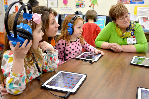 From left, Ella Tuman, Principal Jennifer Fox, Taylor Sidwell and St. Anthony's Memorial Hospital administrator Theresa Rutherford learn more about iPad usage at the Early Learning Center in Effingham. The hospital donated nearly $50,000 to buy additional iPads for several Unit 40 schools. Ella and Taylor are kindergarten students in Michelle Slater's classroom.