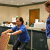 Lorrie Blumer, left, tries exercises with physical therapy assistant Caitlin Sudkamp, right, at St. Anthony's Memorial Hospital Health Fest at the Keller Convention Center. Break-out sessions at the event focused on vascular health, stress and pain, as well as demonstrations and health screenings.