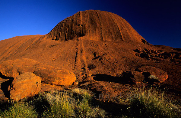 [AUSTRALIA.NTERRITORY 9832] 'Uluru seen from close by.'  Uluru (Ayers Rock) seen from close by, in early morning light. Photo Paul Smit.