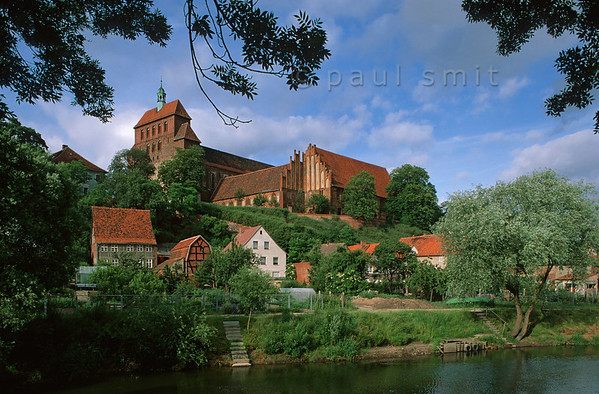 [GERMANY.SACHSENANHALT 11010]  'Fortified cathedral at Havelberg.'  The Domburg rises above the Havel river in the town of Havelberg. This fortified cathedral, with its romanesque tower and gothic hall and monastery buildings, is an exemple of the brick architecture typical for northern Germany. Photo Paul Smit.