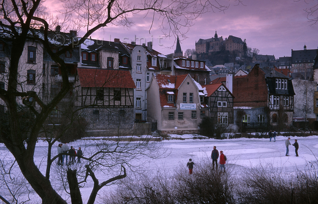[GERMANY.HESSEN 11018] 'Winter in Marburg.'  Skating on a frozen river Lahn. Marburg is one of the smallest university cities of Germany and thanks to its students and to its mainly intact medieval towncenter it is a very pleasant city to live in and to visit. Photo Paul Smit.