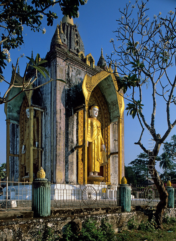 [BURMA 24.721] 'Four Figures Pagoda.'  The Four Figures Pagoda in Bago has four standing Buddha's whose gilded robes shimmer in the late afternoon sun. Photo Mick Palarczyk.