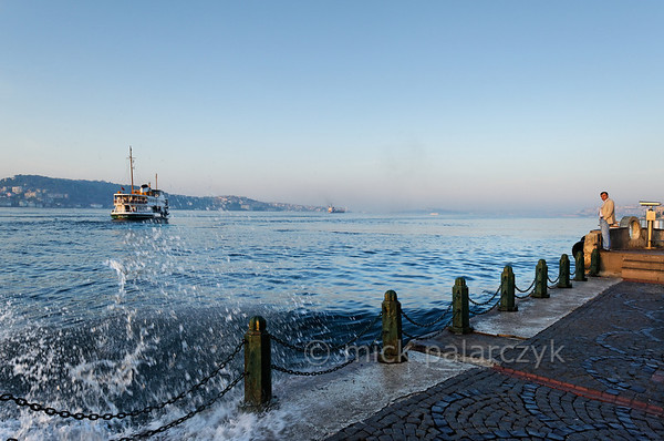 [TURKEY.ISTANBUL 29128 'Bosphorus at Istanbul.'  	The bow waves of a ship slap against the quay of the Bosphorus in Ortaköy, a city district of Istanbul. The hills on the left belong to the Asian part of Turkey. Photo Mick Palarczyk.