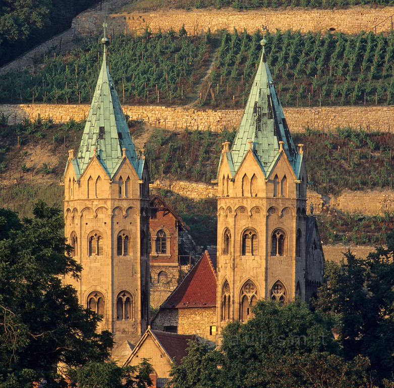 [GERMANY.SACHSENANHALT 11008]  'Marienkirche and vineyards in Freyburg.'  The romanesque towers of the Marienkirche in Freyburg date from the first half of the 13th century. The town of Freyburg lies in the Unstrut valley, known for its Unstrut-Saale wines and, localy, the Rotkäppchen Sekt. Photo Paul Smit.