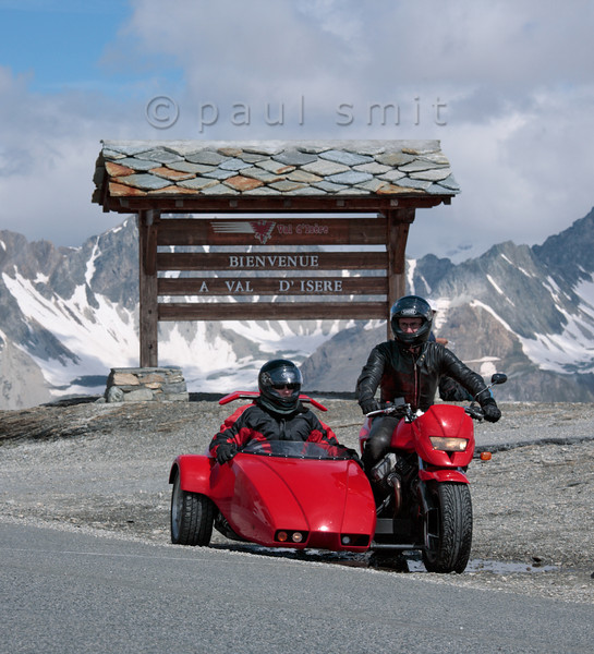 [FRANCE.ALPSNORTH 10932] 'Highest pass of the Alps.'  With 2770 m the Col de l'Iseran is the highest road pass of the Alps, connecting the Tarentaise in the north with the Maurienne in the south. Being a curvy and narrow road, having fabulous views over the snow covered giants of Vanoise and Gran Paradiso, it is a favorite with motorbikers. The Iseran Pass is one of 16 passes in the famous Route des Grandes Alpes. Photo Paul Smit.