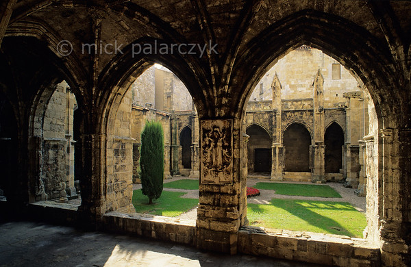 [FRANCE.LANGUEROUS 29633] 'Cloister in Narbonne.'  	Gothic arches surround the cloister of the cathedral in Narbonne. Photo Mick Palarczyk.